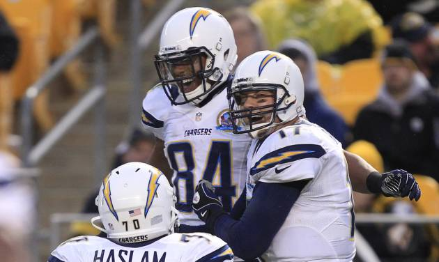 San Diego Chargers quarterback Philip Rivers (17), right,  and wide receiver Danario Alexander (84) celebrate after Alexander made a catch of a Rivers pass for a touchdown in the fourth quarter of an NFL football game against the Pittsburgh Steelerson Sunday, Dec. 9, 2012, in Pittsburgh. The Chargers won 34-24. (AP Photo/Gene J. Puskar)