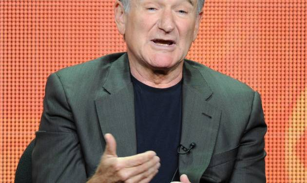 "FILE - In this July 29, 2013 file photo, actor Robin Williams participates in the ""The Crazy Ones"" panel at the 2013 CBS Summer TCA Press Tour at the Beverly Hilton Hotel in Beverly Hills, Calif. The Nielsen company said Friday, Sept. 27, 2013, that Williams' new CBS comedy, ""The Crazy Ones,"" debuted before 15.6 million people on Thursday night. It competed directly at 9 p.m. Eastern with ""The Michael J. Fox"" on NBC, which was seen by 7.2 million people.  (Photo by Frank Micelotta/Invision/AP, File)"