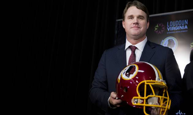 New Washington Redskins head coach Jay Gruden holds a Redskins helmet at the Redskins Park in Ashburn, Va., Thursday, Jan. 9, 2014.  Jay Gruden was introduced as the new Washington Redskins head coach, replacing Mike Shanahan and becoming the team's eighth head coach since Daniel Snyder purchased the franchise in 1999. (AP Photo/Manuel Balce Ceneta)