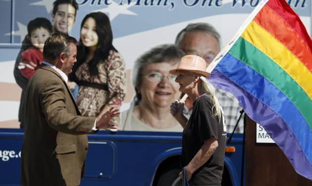 FILE - In this July 28, 2010 file photo, National Organization for Marriage president Brian Brown, left, tells Paula Hare, who is a transgender Vietnam War veteran, not to protest in front of his vehicle outside the state Capitol in St. Paul, Minn. Supporters against gay marriage hope a March for Marriage on Thursday, June 19, 2014, in Washington will draw thousands. (AP Photo/The Star Tribune, Richard Tsong-Taatarii, File)  MANDATORY CREDIT; ST. PAUL PIONEER PRESS OUT; MAGS OUT; TWIN CITIES TV OUT