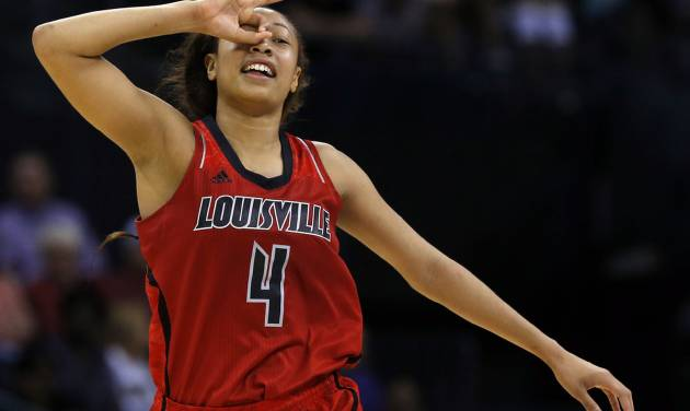 Louisville's Antonita Slaughter (4) celebrates a three-point shot during college basketball game between Baylor University and Louisville at the Oklahoma City Regional for the NCAA women's college basketball tournament at Chesapeake Energy Arena in Oklahoma City, Sunday, March 31, 2013. Photo by Sarah Phipps, The Oklahoman