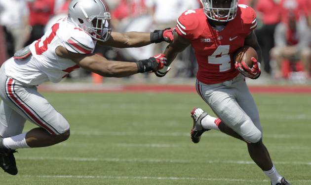 Ohio State running back Curtis Samuel, right, runs around the outside as linebacker Darron Lee defends during their spring NCAA college football game Saturday, April 12, 2014, in Columbus, Ohio. (AP Photo/Jay LaPrete)