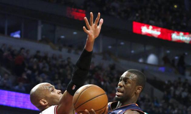 Charlotte Bobcats guard Kemba Walker (15) shoots past Chicago Bulls forward Taj Gibson (22) during the first half of an NBA basketball game Monday, Dec. 31, 2012, in Chicago. (AP Photo/Charles Rex Arbogast)