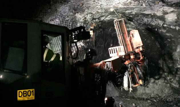 In this May, 2014 photo provided by Eagle Mine a rock bolter, which drills and installs bolts to stabilize the mine, moves through a tunnel at  the mine in Marquette County, Mich. The nickel and copper operation, scheduled to begin production this fall, will pump $4 billion into Marquette County over its eight-year lifespan and employ about 300 while generating economic activity that will create 1,200 additional jobs, according to the company. (AP Photo/Courtesy Eagle Mine)