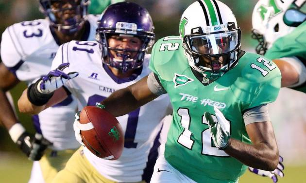 FILE - In this Sept. 8, 2012, file photo, Marshall's Rakeem Cato runs a quarterback keeper as Western Carolina defender Brian Johnson chases him during an NCAA college football game in Huntington, W.Va. Cato enters his senior season with the chance to become the most prolific quarterback in school history. (AP Photo/The Herald-Dispatch, Mark Webb, File)