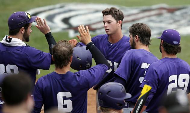 TCU's Keaton Jones, center, celebrates with teammates after scoring in the eighth inning of a game against Baylor in the Big 12 Conference NCAA college baseball tournament in Oklahoma City, Saturday, May 24, 2014. TCU won 4-1 and advances to the championship game on Sunday. (AP Photo/Sue Ogrocki)