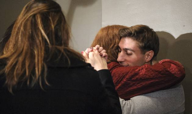 In this photo taken Tuesday, Nov. 12, 2013, Ryan Ferguson hugs his mother Leslie Ferguson during a press conference in Columbia, Mo., after his release from prison. Last week, a state appeals court overturned Ryan's murder and robbery convictions for the 2001 strangling and beating death of Columbia Daily Tribune sports editor Kent Heitholt. The appeals panel said the prosecutor's office had withheld evidence from defense attorneys and Ferguson did not receive a fair trial. (AP Photo/The Columbia Daily Tribune, Nick Schnelle)