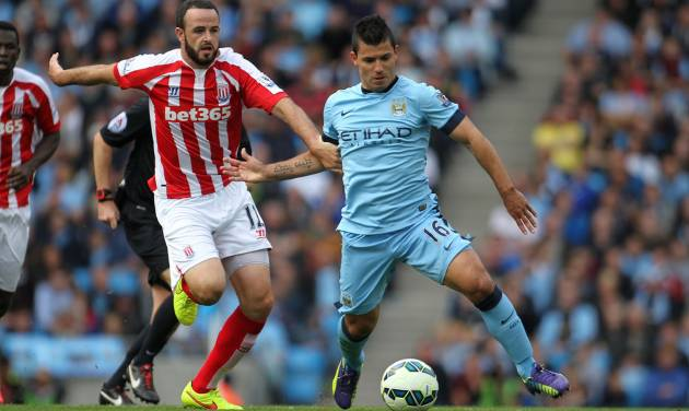 Stoke City's Marc Wilson, left, and Manchester City's Sergio Aguero battle for the ball during their English Premier League soccer match at the Etihad Stadium, Manchester, England, Saturday, Aug. 30, 2014. (AP Photo/Lynne Cameron, PA Wire)     UNITED KINGDOM OUT    -   NO SALES   -   NO ARCHIVES