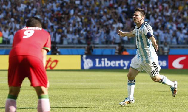 Argentina's Lionel Messi celebrates after scoring during the group F World Cup soccer match between Argentina and Iran at the Mineirao Stadium in Belo Horizonte, Brazil, Saturday, June 21, 2014. Argentina won 1-0.  (AP Photo/Jon Super)