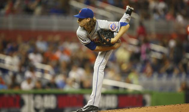New York Mets starting pitcher Jacob deGrom throws to the Miami Marlins during the first inning of a baseball game in Miami, Saturday, June 21, 2014. (AP Photo/J Pat Carter)