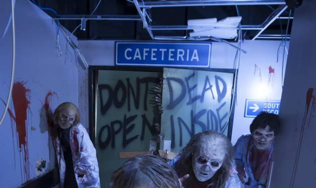 "This image provided by Universal Orlando Resort shows actors portraying zombies at an attraction themed on the AMC show ""The Walking Dead"" at Universal's Halloween Horror Nights in Orlando, Fla. The theme park also has attractions inspired by the video game and movie ""Silent Hill,"" Alice Cooper's concept album ""Welcome to My Nightmare"" and a House of Horrors featuring classic monsters from Universal films. (AP Photo/Universal Orlando Resort, Kevin Kolczynski)"