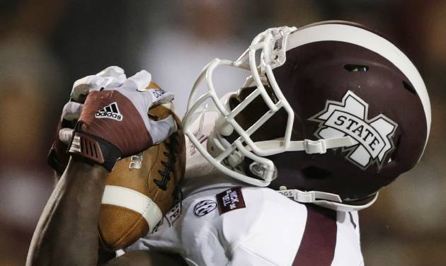 Mississippi State wide receiver Chad Bumphis (1) catches a touchdown pass in the first half of a NCAA college football game against Troy in Troy, Ala., Saturday, Sept. 15, 2012. (AP Photo/Dave Martin)
