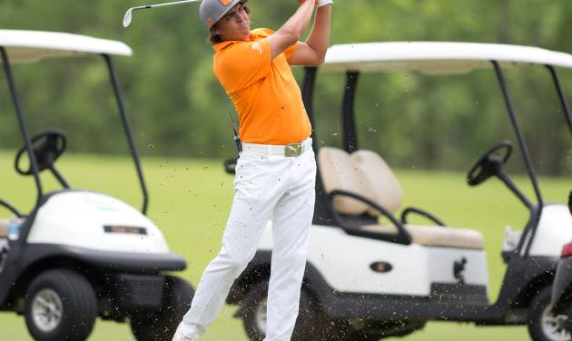 Professional golfer Rickie Fowler eyes his second shot to the green on the 16th fairway during the 4th Annual Folds of Honor Patriot Cup on May 27, 2013.  JOEY JOHNSON/For the Tulsa World ORG XMIT: DTI1305271809378530