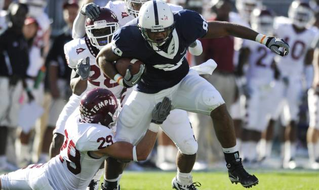 In this photo taken Sept. 25, 2010, Penn State's Garry Gilliam fights for extra yards in the second quarter of an NCAA college football game agains Temple in State College, Pa. After two knee injuries, tight end Garry Gilliam is going from the sidelines to a possibly a feature player of the offense in coach Bill O'Brien's new system. Gilliam is one of three key Nittany Lions trying to bounce back from knee problems this spring. (AP Photo/Centre Daily Times (Knight Ridder), Nabil K. Mark ) MANDATORY CREDIT; MAGS OUT