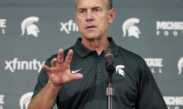 Michigan State coach Mark Dantonio addresses the media during the team's NCAA college football media day, Monday, Aug. 4, 2014, in East Lansing, Mich. (AP Photo/Al Goldis)