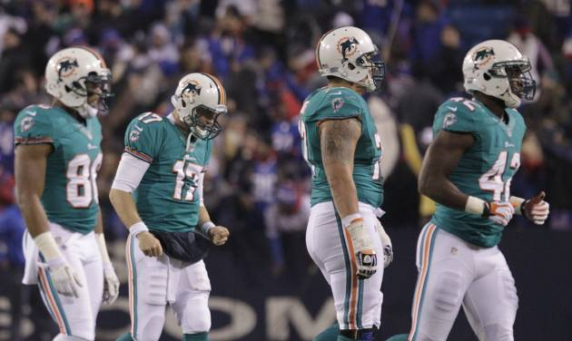 Miami Dolphins quarterback Ryan Tannehill (17) leaves the field with teammates after throwing an interception to end the second half of an NFL football game against the Buffalo Bills Thursday, Nov. 15, 2012 in Orchard Park, N.Y. The Bills won the game 19-14. (AP Photo/Bill Wippert)