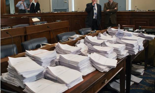 FILE - This May 15, 2013 file photo shows stacks of paperwork awaiting members of the House Agriculture Committee on Capitol Hill in Washington, Wednesday, May 15, 2013, as it meets to consider proposals to the 2013 Farm Bill. The House has rejected a five year, half-trillion-dollar farm bill that would have cut $2 billion annually from food stamps and let states impose broad new work requirements on those who receive them. (AP Photo/J. Scott Applewhite, File)