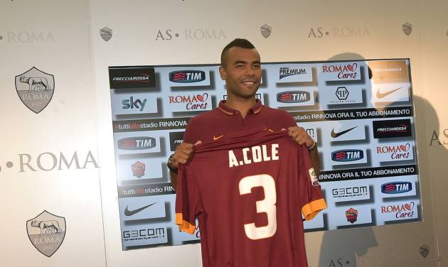 Former Chelsea left back Ashley Cole poses with his new Roma jersey during the official presentation in Rome Tuesday, July 15, 2014. Cole signed a two-year deal with Roma last week and was presented with the Giallorossi's No. 3 shirt Tuesday. The 33-year-old Cole spent the past eight seasons with Chelsea, and was with London rival Arsenal for the previous six years. (AP Photo/Alfredo Falcone, Lapresse) ITALY OUT