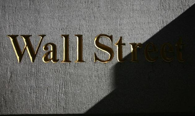 FILE - In this Monday, March 8, 2010, file photo, a sign for Wall Street is shown near the New York Stock Exchange. World stock markets struggled for direction Tuesday, June 24, 2014, after Wall Street fell for the first time in seven days, in a possible sign that investors were pausing to re-evaluate the market's recent highs. (AP Photo/Mark Lennihan, File)