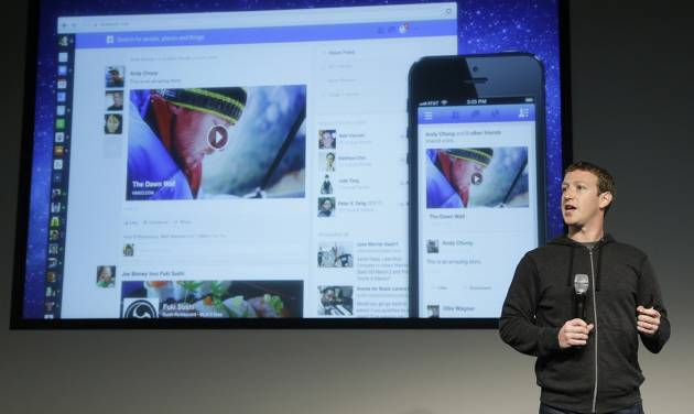Facebook CEO Mark Zuckerberg speaks at Facebook headquarters in Menlo Park, Calif., Thursday, March 7, 2013. Zuckerberg on Thursday unveiled a new look for the social network's News Feed, the place where its 1 billion users congregate to see what's happening with their friends, family and favorite businesses.(AP Photo/Jeff Chiu)