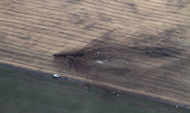 This photo provided by Stan Dammel shows a field near Harrington, Wash. where a E/A-6B Prowler military airplane from Naval Air Station Whidbey Island crashed Monday, March 11, 2013. The U.S. Navy said all three crew members aboard the plane died in the crash. (AP Photo/Courtesy of Stan Dammel)