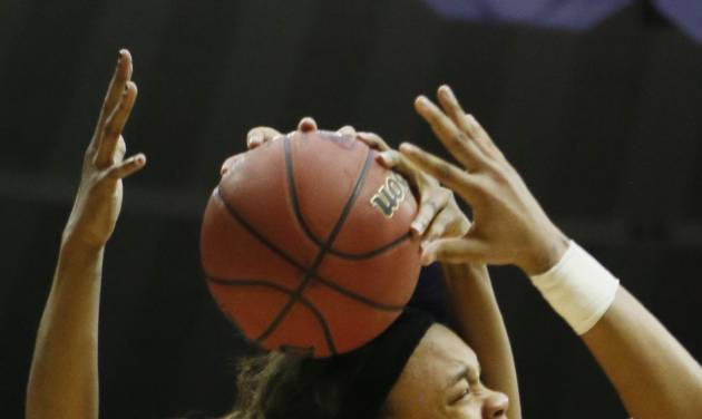 West Virginia center Asya Bussie (20) rejects a layup attempt by LSU guard Danielle Ballard (32) in the second half of an NCAA college basketball second-round tournament game Tuesday, March 25, 2014, in Baton Rouge, La. LSU won 76-67. (AP Photo/Rogelio V. Solis)