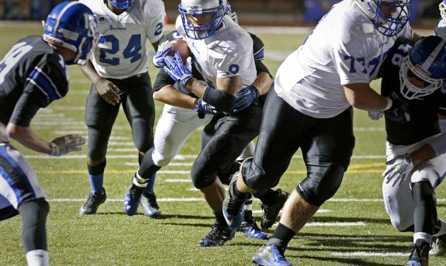 Guthrie's Kai Callins scores a touchdown against Deer Creek during a high school football game at Deer Creek in Oklahoma City, Friday, October 25, 2013. Photo by Bryan Terry, The Oklahoman