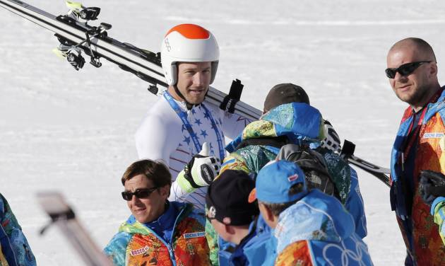 United States' Bode Miller talks to Olympic staff after a men's downhill training run for the Sochi 2014 Winter Olympics, Saturday, Feb. 8, 2014, in Krasnaya Polyana, Russia. the 2014 Winter Olympics, Saturday, Feb. 8, 2014, in Krasnaya Polyana, Russia. (AP Photo/Christophe Ena)