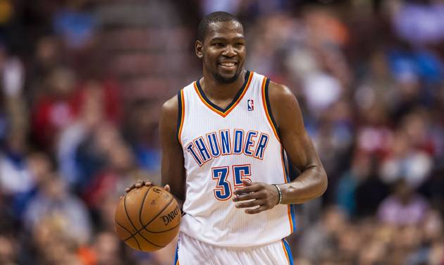<p>Jan 25, 2014; Philadelphia, PA, USA; Oklahoma City Thunder forward Kevin Durant (35) brings the ball up court during the second quarter against the Philadelphia 76ers at the Wells Fargo Center. Mandatory Credit: Howard Smith-USA TODAY Sports</p>
