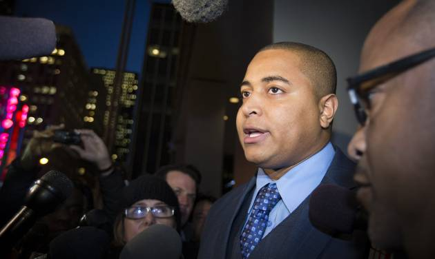 Miami Dolphins lineman Jonathan Martin speaks to members of the media outside the office of the NFL lawyer investigating the team's bullying scandal, Friday, Nov. 15, 2013, in New York. The league is trying to gather information about the harassment Martin says he was subjected to by teammate Richie Incognito. (AP Photo/John Minchillo)