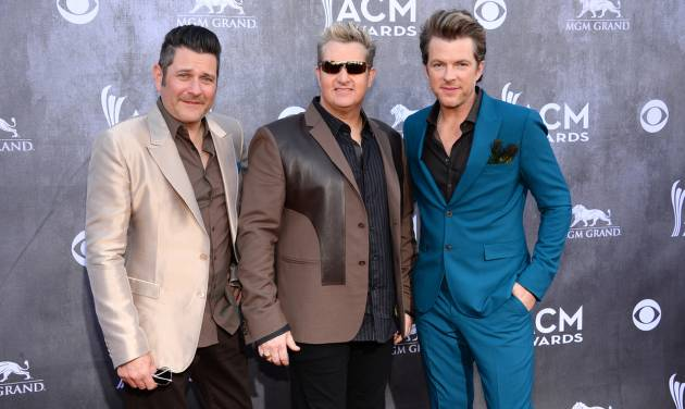 FILE - This April 6, 2014 file photo shows from left, Jay DeMarcus, Gary LeVox and Joe Don Rooney, of the musical group Rascal Flatts, at the 49th annual Academy of Country Music Awards in Las Vegas. LeVox has lost his voice forcing Rascal Flatts to cancel three shows in the Pacific Northwest this week. The country band issued a news release Wednesday, Aug. 6, announcing dates in Nampa, Idaho, on Thursday, Airway Heights, Washington, and Mission, British Columbia, Canada, where they were set to appear at the Rockin' River Music Festival, have been canceled. (Photo by Al Powers/Powers Imagery/Invision/AP, File)