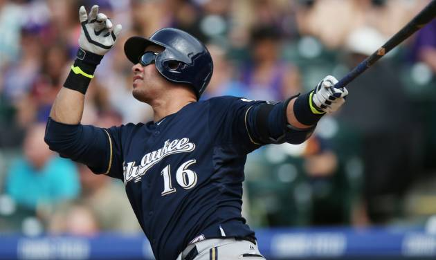 Milwaukee Brewers' Aramis Ramirez follows the flight of his solo home run against the Colorado Rockies in the fifth inning of a baseball game in Denver, Saturday, June 21, 2014. (AP Photo/David Zalubowski)