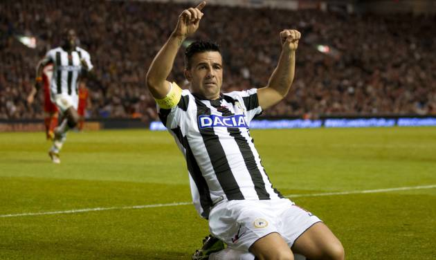 Udinese's Antonio Di Natale celebrates after scoring against Liverpool, during their Europa League Group A soccer match at Anfield Stadium, Liverpool, England, Thursday Oct. 4, 2012. (AP Photo/Jon Super)