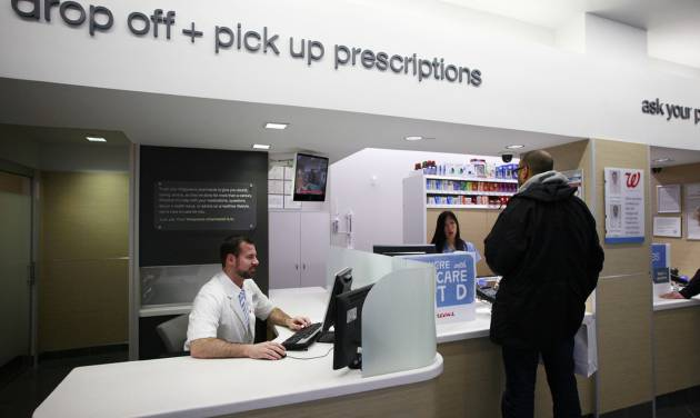 FILE - In this Wednesday, May 15, 2013, file photo, a pharmacist works at his desk located next to the prescription pick up counter in New York. New details from two studies reveal more side effects from niacin, a drug that hundreds of thousands of Americans take for cholesterol problems and general heart health.  (AP Photo/Mark Lennihan, File)