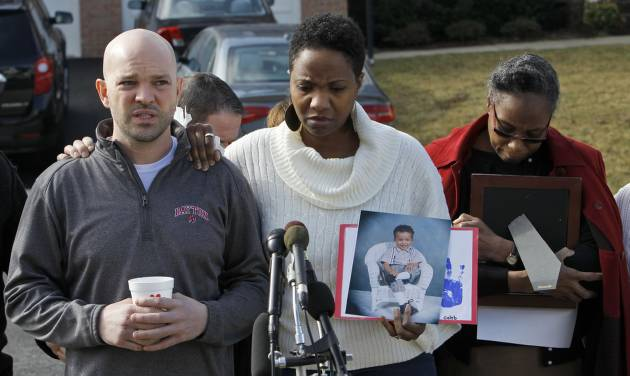 Shawn Gordley, left, and Jennea Gordley, center, parents of Caleb Gordley, accompanied by family and friends of Caleb Gordley, talk to members of the media outside their home in Sterling, Va., Tuesday, March 19, 2013. Police say Caleb Gordley, a Loudoun County teenager was shot and killed after he climbed into a neighbor's home through a back window.  (AP Photo/Ann Heisenfelt)