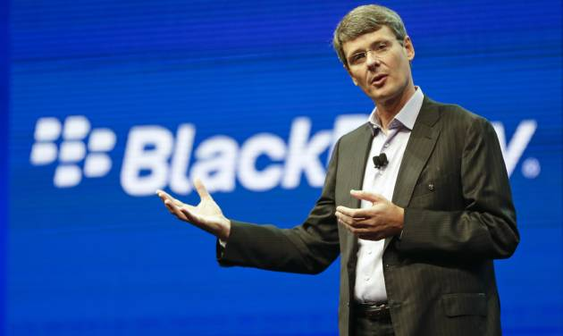 In this May 14, 2013 photo, Thorsten Heins, president and CEO at BlackBerry, speaks at a conference in Orlando, Fla. BlackBerry on Friday, Sept. 20, 2013 said that it will lay off 4,500 employees, or 40 percent of its global workforce, as it reports a nearly $1 billion second-quarter loss a week earlier than the results were expected. (AP Photo/John Raoux, File)