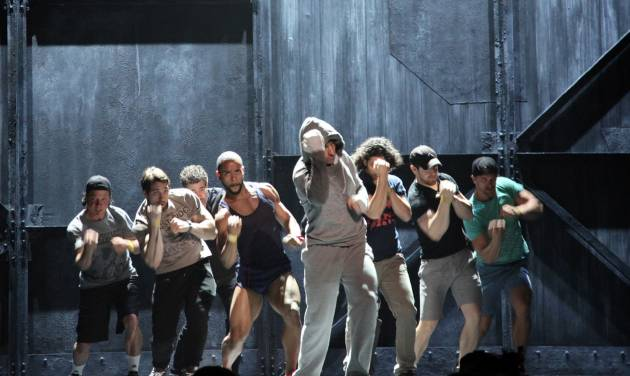 """Andy Karl, center, performs with the cast of """"Rocky: The Musical,"""" during a rehearsal for the Tony Awards at Radio City Music Hall on Friday, June 6, 2014, in New York. Sunday's Tony Awards telecast will feature the usual black ties, soaring songs and gentle jokes _ and an eye-popping boxing match between Rocky and Apollo Creed in a regulation-size ring on the Radio City Music Hall stage. (AP Photo/Mark Kennedy)"""