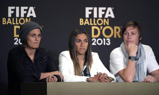 Nadine Angerer of Germany, left, Marta   of Brazil, center, and Abby Wambach of the United, right, nominees for the FIFA Women's World  Soccer Player of the Year, attend a press conference at the FIFA Ballon d'Or Gala 2013  in Zurich, Switzerland, Monday, Jan.  13, 2014 (AP Photo/Keystone,Walter Bieri)