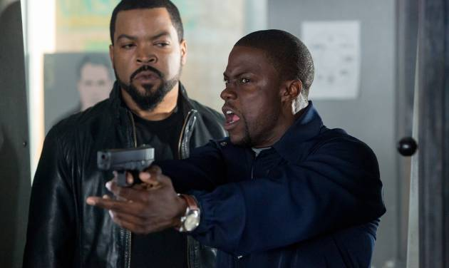 """FILE - This image released by Universal Pictures shows Ice Cube, left, and Kevin Hart in a scene from """"Ride Along."""" The PG-13 monster thriller """"I, Frankenstein"""" will attempt to capitalize on a football-free weekend and try to unseat box-office leader """"Ride Along,"""" the Kevin Hart comedy. (AP Photo/Universal Pictures, Quantrell D. Colbert, File)"""