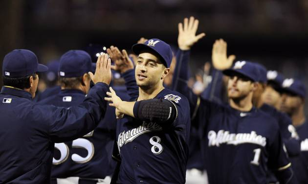 Milwaukee Brewers' Ryan Braun (8) celebrates with teammates at the end of a baseball game against the Philadelphia Phillies, Wednesday, April 9, 2014, in Philadelphia. The Brewers won 9-4. (AP Photo/Michael Perez)