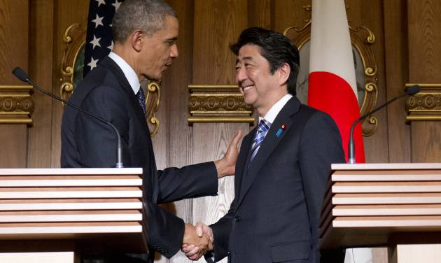 President Barack Obama, left, and Japanese Prime Minister Shinzo Abe shake hands at the conclusion of their joint news conference at the Akasaka State Guest House in Tokyo, Thursday, April 24, 2014. Obama said Thursday that he wants to see a dispute between China and Japan over islands in the East China Sea resolved peacefully, while affirming that America's mutual security treaty with Japan applies to the islands. (AP Photo/Carolyn Kaster)
