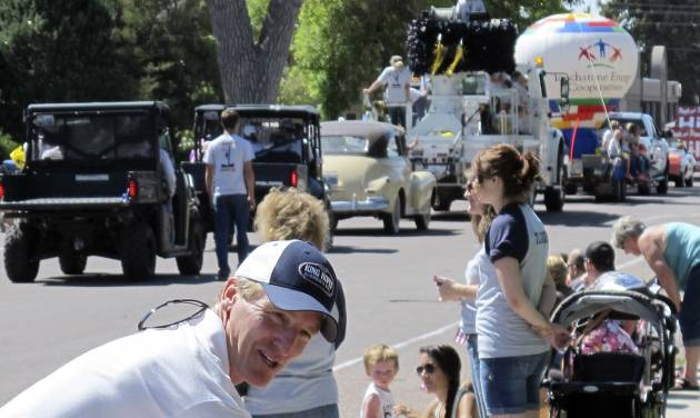 In this photo taken on July 31, 2014, Pete Gosar talks to the crowd at  a parade in Torrington, Wyo. Gosar stepped down this summer as chairman of the Wyoming Democratic Party and is seeking the Democratic Party nomination for governor in the state's Aug. 19 primary election.  (AP Photo/Ben Neary)
