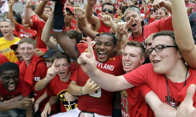 Maryland quarterback Demetrius Hartsfield, center, celebrates with fans after defeating William & Mary 7-6 in an NCAA college football game, Saturday, Sept. 1, 2012, in College Park, Md. (AP Photo/Luis M. Alvarez)