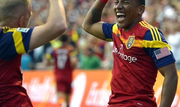 Real Salt Lake midfielder Luke Mulholland, left, congratulates Jou Plata (8) after Plata's goal in the first period of their MLS soccer match against the Colorado Rapids, Saturday, May 17 2014, in Sandy, Utah. (AP Photo/The Salt Lake Tribune, Rick Egan)  DESERET NEWS OUT; LOCAL TV OUT; MAGS OUT.