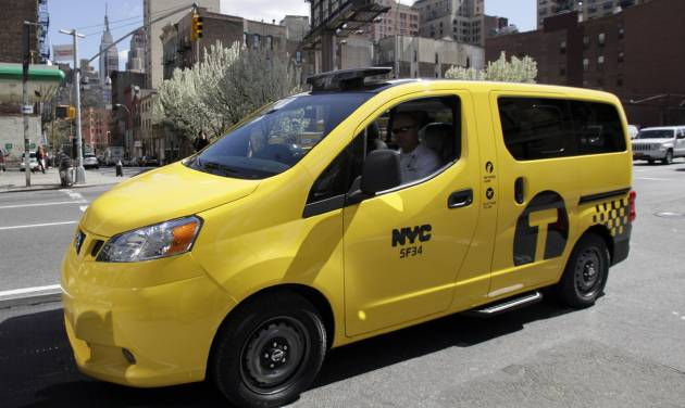 FILE- In this April 2, 102 file photo, a prototype of the Nissan NV 200 New York City taxi is shown in New York. An Appeal's Court in New York has ruled on Tuesday, June 9, 2014, that New York City taxi owners can be compelled by the Taxi and Limousine Commission to purchase the Nissan taxis as they replace existing vehicles in their fleets. Under the plan, cab owners will be required to replace most cabs they retire with the NV-200, which has a suggested retail price of $29,700.  (AP Photo/Richard Drew, File)