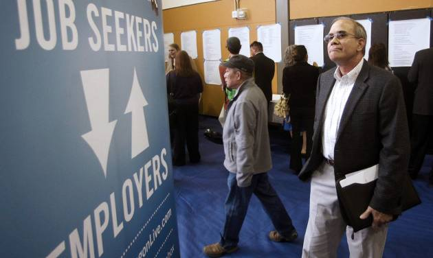 FILE - In this April 24, 2012, file photo, job seeker Alan Shull attends a job fair in Portland, Ore. The Labor Department said Friday, May 4, 2012, that the economy added just 115,000 jobs in April. U.S. employers pulled back on hiring for the second straight month, evidence of an economy still growing only sluggishly. The unemployment rate fell to 8.1 percent, but only because more people gave up looking for work. (AP Photo/Rick Bowmer, File)