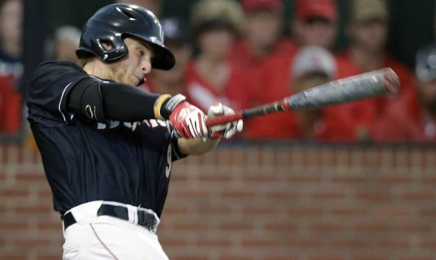 Louisiana Lafayette's Tyler Girouard (9) hits a three run home run in the third inning of an NCAA college baseball tournament super regional game against Mississippi in Lafayette, La., Saturday, June 7, 2014. (AP Photo/Gerald Herbert)