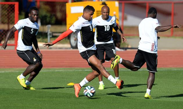 Ghana's Michael Essien, Kevin Prince Boateng and Andre Ayew, from left to centre, challenge for the ball during a training session in Brasilia, Brazil, Wednesday, June 25, 2014. Ghana will play Portugal in group G of the 2014 soccer World Cup on June 26. (AP Photo/Paulo Duarte)