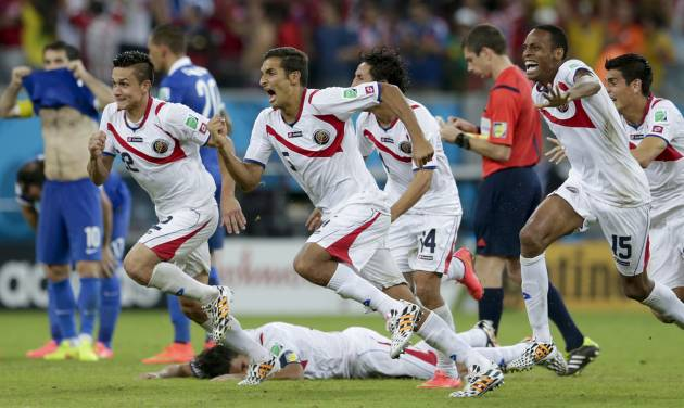 Costa Rica players react after Michael Umana scored during a shootout after regulation time in the World Cup round of 16 soccer match between Costa Rica and Greece at the Arena Pernambuco in Recife, Brazil, Sunday, June 29, 2014. Costa Rica defeated Greece 5-3 in penalty shootouts after a 1-1 tie. (AP Photo/Petr David Josek)