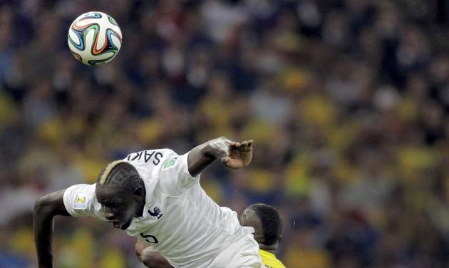 France's Mamadou Sakho collides with Ecuador's Enner Valencia as they try to head the ball during the group E World Cup soccer match between Ecuador and France at the Maracana Stadium in Rio de Janeiro, Brazil, Wednesday, June 25, 2014. (AP Photo/Bernat Armangue)